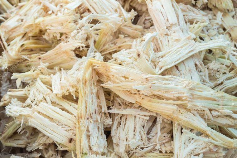 depositphotos_65957735-stock-photo-stack-bagasse-of-sugarcane
